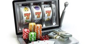 55369624 - casino online concept, gambling. laptop slot machine with dice, cards and packs of dollar. 3d